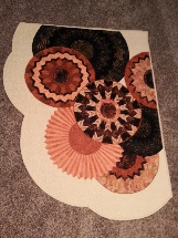 Pieced and apliquéd, machine quilted wall hanging