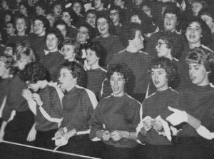 In cheer block, seniors sat in front. (Singing school song. (Me: front, far right.)